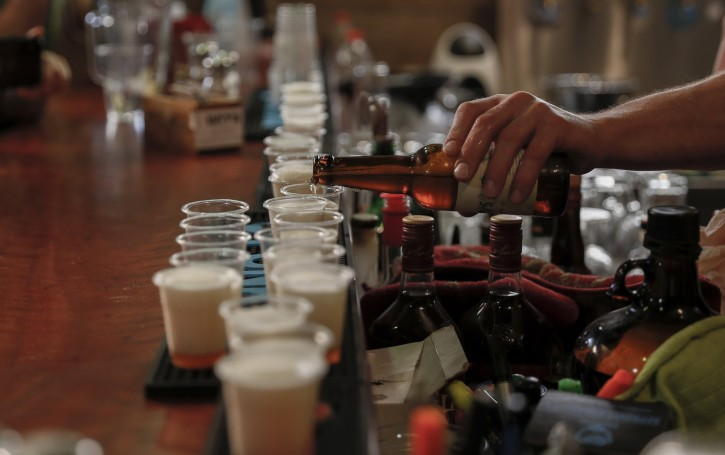Israeli waiter pours a beer for test, during a press conference organised by the Israel Antiquities Authority, in Jerusalem  to present and reveal a unique way to isolate yeast from ancient pottery, from which high-quality beers were then produced, on 21 May 2019.  EPA