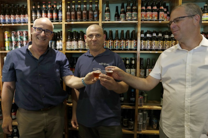 Professors Aren Maeir at Bar Ilan University (L) Dr Yitzhak Paz from the Israel Antiquities Authority (C) and  Professor Yuval Gadot  from Tel Aviv University pose during a press conference organised by the Israel Antiquities Authority, in Jerusalem  to present and reveal a unique way to isolate yeast from ancient pottery, from which high-quality beers were then produced, on 21 May 2019.  EPA