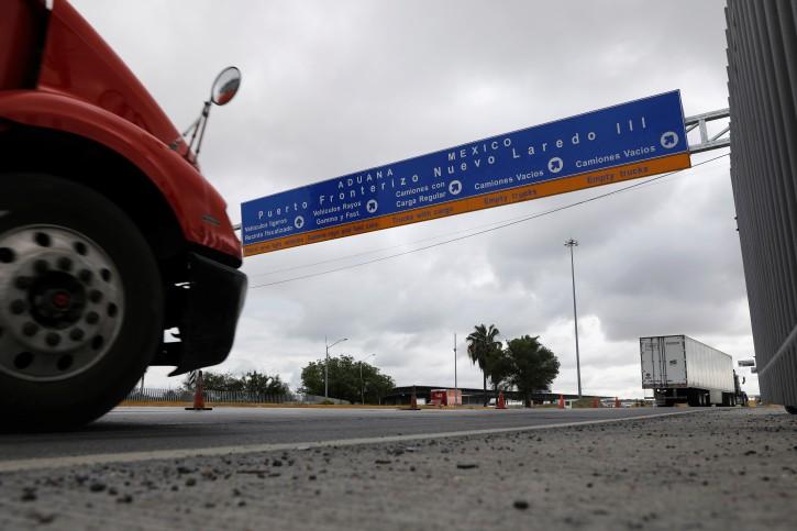 Trucks are seen arriving at a border customs control to cross into U.S. at the World Trade Bridge in Nuevo Laredo, Mexico  June 5, 2019. REUTERS/Carlos Jasso