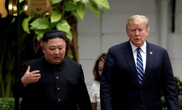 FILE - North Korea's leader Kim Jong Un and U.S. President Donald Trump talk in the garden of the Metropole hotel during the second North Korea-U.S. summit in Hanoi, Vietnam February 28, 2019. REUTERS/Leah Millis/File Photo