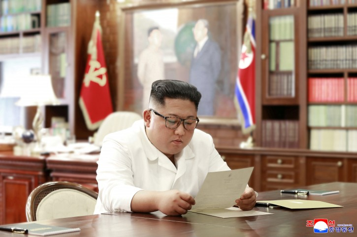 North Korean leader Kim Jong Un reads a letter from U.S. President Donald Trump, in Pyongyang, North Korea in this picture released by North Korea's Korean Central News Agency (KCNA) on June 22, 2019. KCNA via REUTERS