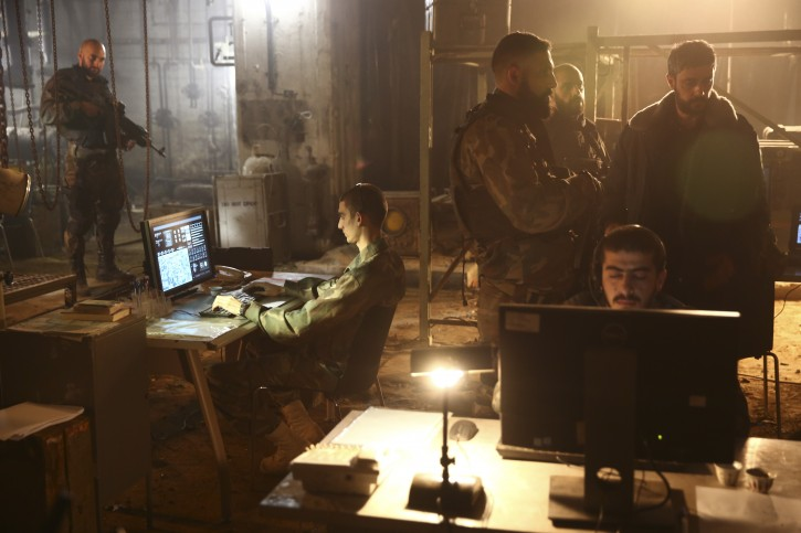"""In this Thursday, May 30, 2019 photo, actors play their roles during a scene on the set of Israel's hit TV show """"Fauda,"""" in Tel Aviv, Israel. After two successful seasons, co-creators Avi Issacharoff and Lior Raz are hard at work on their much-anticipated third season, a good portion of which takes place in the Gaza Strip. The season debut date for the Netflix hit hasn't been revealed, but the trailer is being released this week. (AP Photo/Oded Balilty)"""