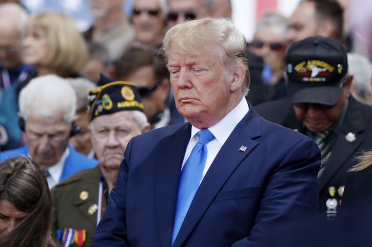 President Donald Trump participates in a ceremony to commemorate the 75th anniversary of D-Day at the American Normandy cemetery, Thursday, June 6, 2019, in Colleville-sur-Mer, Normandy, France. (AP Photo/Alex Brandon)