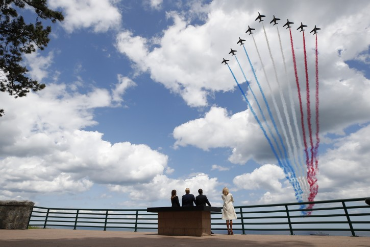 President Donald Trump, first lady Melania Trump, French President Emmanuel Macron and Brigitte Macron, watch a flyover during a ceremony to commemorate the 75th anniversary of D-Day at the American Normandy cemetery, Thursday, June 6, 2019, in Colleville-sur-Mer, Normandy, France. (AP Photo/Alex Brandon)