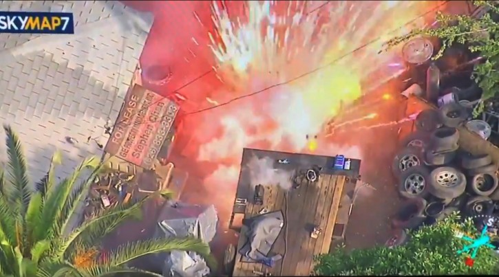 This photo from video provided by KABC-TV shows fireworks released by a barricade gunman in San Gabriel, Calif. Authorities have a surrounded a burning Los Angeles-area home where a gunman earlier fired at police. Nobody has been hurt but the hours-long standoff continues in San Gabriel. Nearby Interstate 10 freeway has been shut down, jamming traffic for miles. (KABC-TV via AP)
