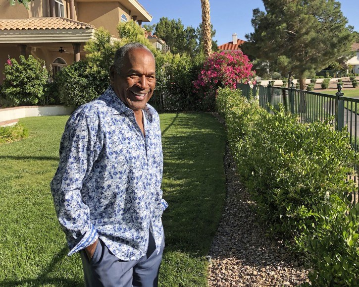 This photo provided by Didier J. Fabien shows O.J. Simpson in the garden of his Las Vegas-area home on Monday, June 3, 2019. AP