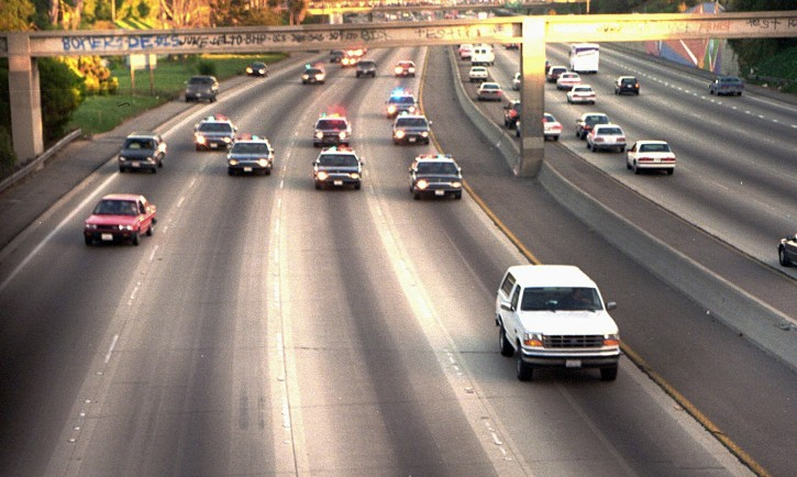 FILE - In this June 17, 1994 file photo, a white Ford Bronco, driven by Al Cowlings carrying O.J. Simpson, is trailed by Los Angeles police cars as it travels on a freeway in Los Angeles. AP