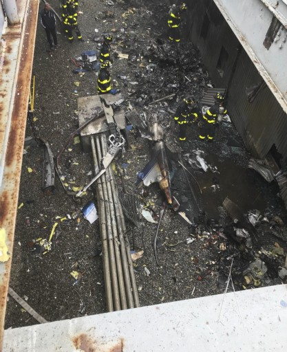 In this Monday, June 10, 2019 photo released by the New York City Fire Department, damage caused by a helicopter crash at 787 7th Avenue in New York is shown.  (AP Photo via FDNY)