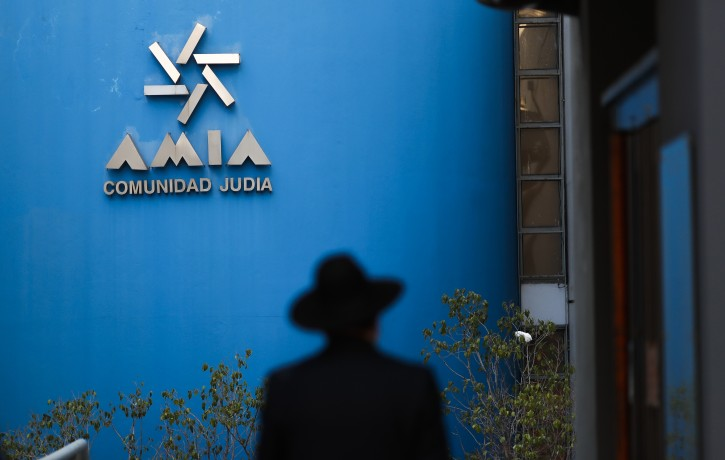FILE - A man enters the headquarters of the Argentine Jewish Mutual Aid Society (AMIA, in Spanish). EPA