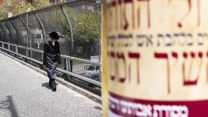 FILE - A man walks along a sidewalk in the Orthodox Jewish area of the Williamsburg neighborhood in Brooklyn, New York, USA, 25 April 2019. EPA