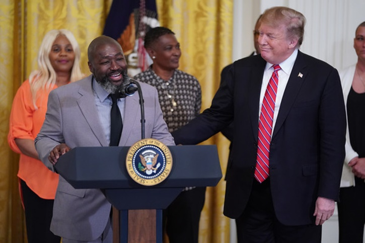 """Matthew Charles, who was released from from federal prison after serving 20 years for selling crack cocaine, joins U.S. President Donald Trump for a First Step Act celebration in the East Room of the White House April 01, 2019 in Washington, DC. The First Step Act passed Congress with bipartisan support in December 2018, prompting the release of more than 500 inmates as a result. Trump praised the reform legislation as proof that the United States """"believes in redemption."""" Reuters"""
