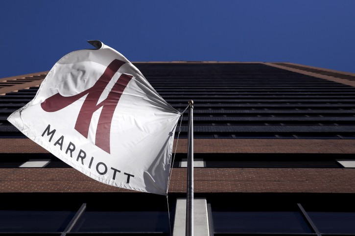 A Marriott flag hangs at the entrance of the New York Marriott Downtown hotel in Manhattan, New York November 16, 2015. REUTERS