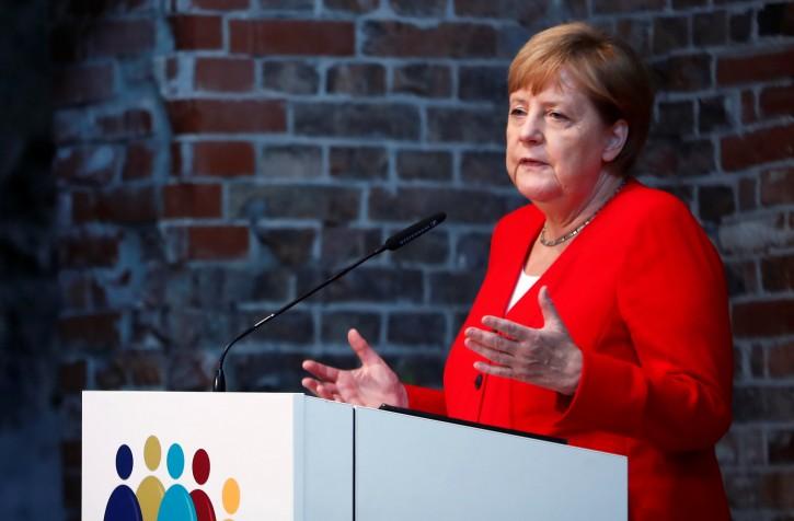 German Chancellor Angela Merkel speaks during a ceremony to mark 50 years of German development aid in Berlin, Germany, July 12, 2019. REUTERS/Hannibal Hanschke