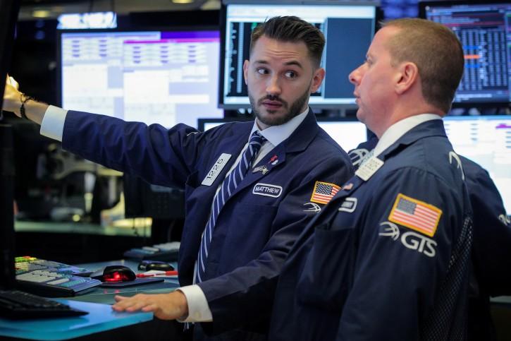 Traders work on the floor at the New York Stock Exchange (NYSE) in New York, U.S., July 1, 2019. REUTERS/Brendan McDermid
