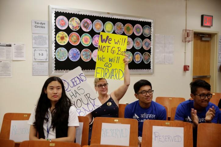 Constituents listen to Representative Alexandria Ocasio-Cortez speak during an Immigration Town Hall at The Nancy DeBenedittis Public School in Queens, New York, U.S. July 20, 2019. REUTERS/Gabriella Angotti-Jones