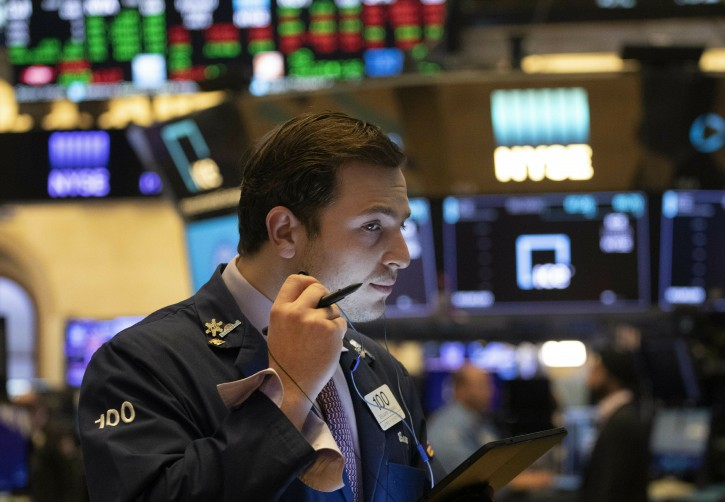 FILE - In this July 5, 2019, file photo trader Benjamin Tuchman works at the New York Stock Exchange in New York. (AP Photo/Mark Lennihan, File)
