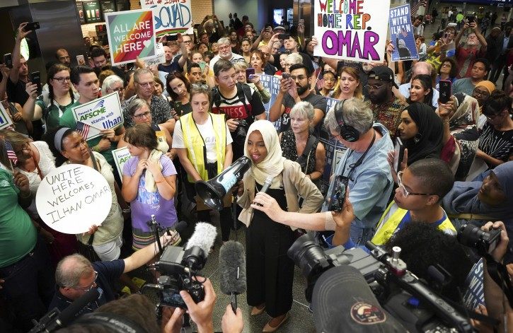 """Rep. Ilhan Omar was greeted Wednesday by more than a hundred supporters cheering """"Welcome Home Ilhan"""" as she arrived home to MSP Airport. This in the wake of increased attacks from the president and chants of """"Send her back"""" at a rally Wednesday.     ] GLEN STUBBE • glen.stubbe@startribune.com   Thursday, July 18, 2019"""