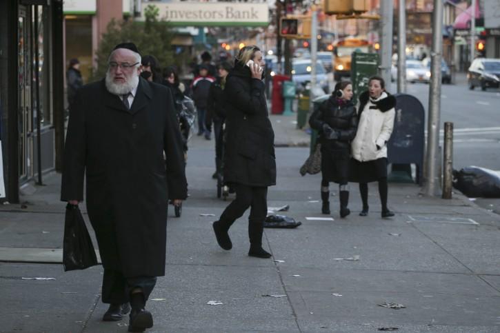 FILE - Ultra Orthodox Jews seen walking on a street in Borough Park neighborhood in the southwestern borough of Brooklyn, New York City. Flash90