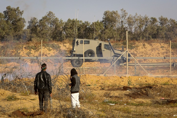 FILE - Palestinian protesters clash with Israeli security forces during a protest on the Israel-Gaza border, in the eastern part of Rafah, in the southern Gaza Strip on May 10, 2019. (Abed Rahim Khatib/Flash90)