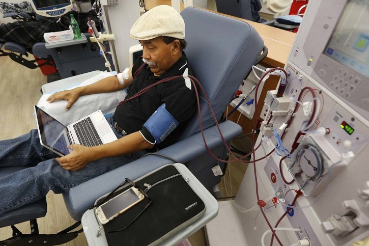 Adrian Perez undergoes dialysis at a DaVita Kidney Care clinic in Sacramento, California in 2018. About 30 million Americans suffer from some form of kidney disease, which was the nation's ninth leading cause of death in 2017.   Rich Pedroncelli/AP Photo