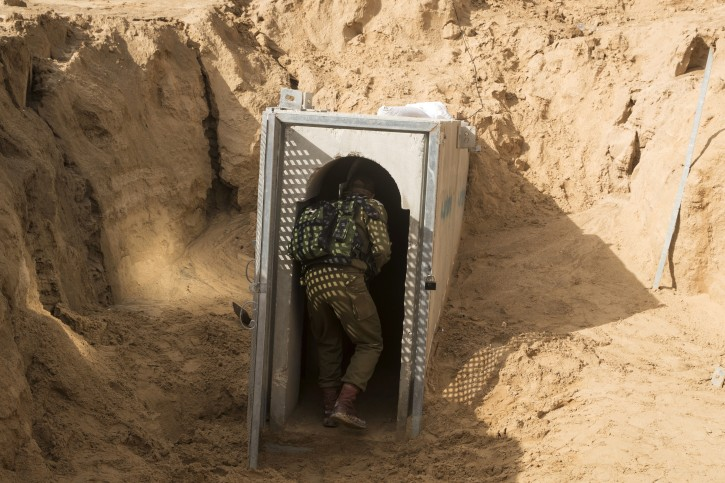 FILE -  A picture taken on 18 January 2018 from the Israeli side of the border with the Gaza Strip showing a Israeli army officer walking near the entrance of a tunnel near southern Israeli kibbutz of Kissufim. EPA