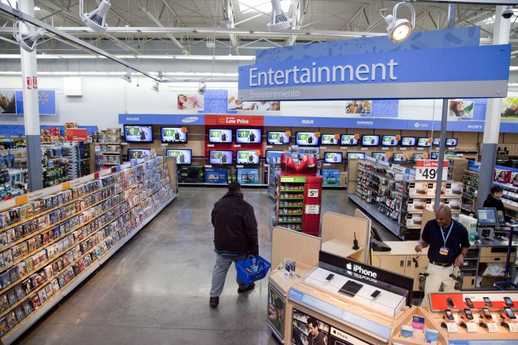 FILE = In this Dec. 15, 2010 file photo, a view of the entertainment section of a Wal-Mart store is seen in Alexandria, Va.  Walmart is taking down all signs and displays from its stores that depict violence, following a mass shooting at its El Paso, Texas location that left 22 people dead. AP