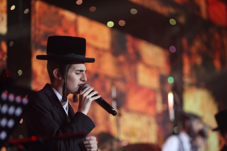 FILE - Ultra orthodox singer Motty Steinmetz performs during an event to raise money for Ultra Orthodox residents from Ramot Aleph, at the International Convention Center in Jerusalem. Photo by Yaakov Naumi/Flash90