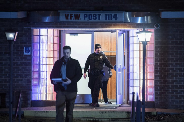 FILE - In this Jan. 13, 2019 file photo, Evansville Police officers exit the VFW Post in Evansville, Ind., after a shooting in the Bingo Hall. A southwestern Indiana man has been convicted in the shooting inside a crowded Veterans of Foreign Wars post that wounded one person. A jury found John Michael Burghardt of Evansville guilty Wednesday, Aug. 7, 2019, on six charges, including two counts of attempted murder.(MaCabe Brown/Evansville Courier & Press via AP File)